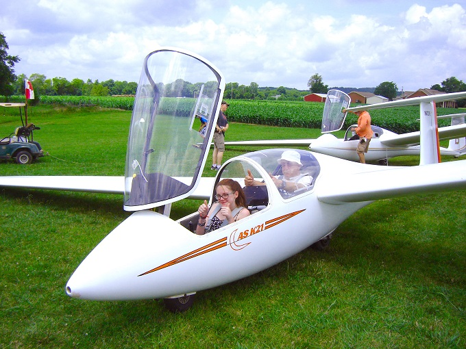 "Mackenzie Holder (seated in front), a Coffee County Middle School student participating in the AEDC STEM Aviation Program, gives the ""thumbs up"" before beginning her glider flight for the program graduation July 8, 2016, in Eagleville, Tenn."